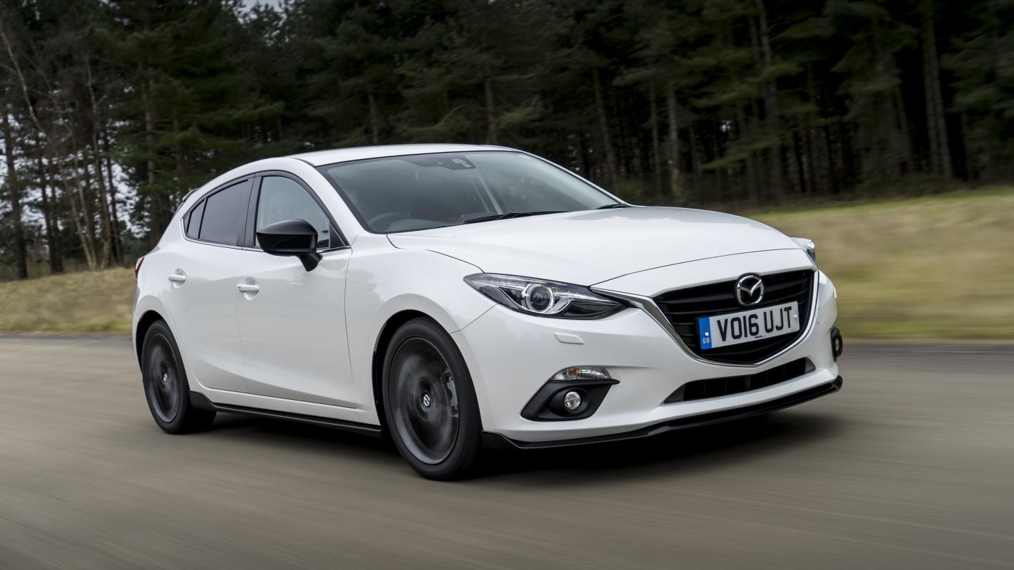 White  Mazda  Hatchback Touring